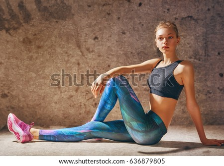 Healthy lifestyle and sport concepts. Woman in fashionable sportswear is doing exercise.