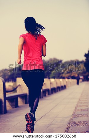 healthy lifestyle beautiful asian woman running at seaside under sunrise