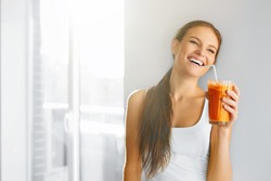 Healthy Lifestyle. Closeup Of Beautiful Smiling Vegetarian Woman Drinking Fresh Raw Detox Vegetable Juice. Healthy Food Eating, Diet And Lifestyle Concept. Drinks. Beauty Concept.