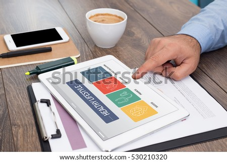 HEALTHY LIFESTYLE CONCEPT ON TABLET SCREEN - Shutterstock ID 530210320
