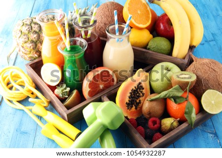 Healthy lifestyle concept. sport fitness equipment-several bottles with fruit and berry juices smoothies and milkshakes , jumping rope
