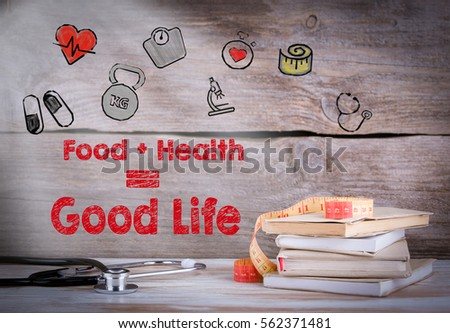 Healthy Lifestyle Concept. Stack of books and a stethoscope on a wooden background