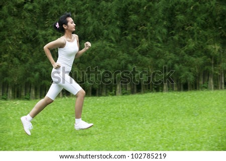 Healthy Lifestyle concept with Pretty woman running in the garden