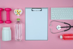 Healthy lifestyle dietetics concept with stethoscope. The idea of how to achieve harmony and longevity while slimming. Empty copy space, clip board mock up, pink background.