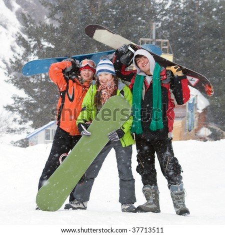 Healthy lifestyle image of happy snowboarders team, 	Snowfall