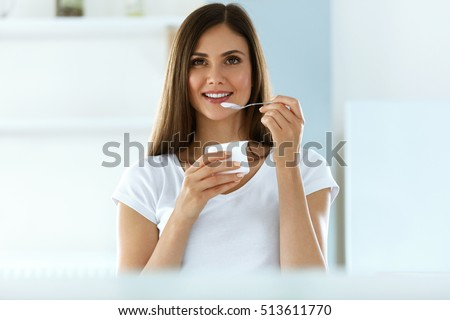 Healthy Lifestyle. Portrait Of Beautiful Sexy Smiling Woman Tasting Fresh Organic Yogurt. Charming Cheerful Girl On Diet Nutrition Eating Delicious Natural Yoghurt, Dairy Food. High Resolution