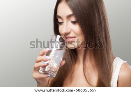 Healthy Lifestyle. Portrait Of Happy Smiling Young Woman With Glass Of Fresh Water. Healthcare. Drinks. Health, Beauty, Diet Concept. Healthy Eating. - Shutterstock ID 686855659