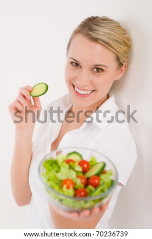 Healthy lifestyle - smiling woman with vegetable salad on white - stock photo