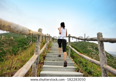 healthy lifestyle sports woman running on mountain stairs