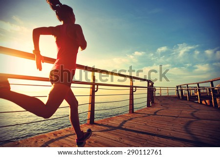 healthy lifestyle sports woman running on wooden boardwalk sunrise seaside ,vintage effect