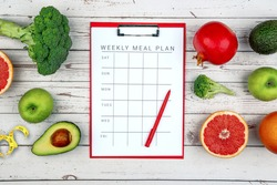 Healthy lifestyle workout concept with training equipment. The idea of how to achieve harmony and longevity while Slimming. Weekly meal plan tab