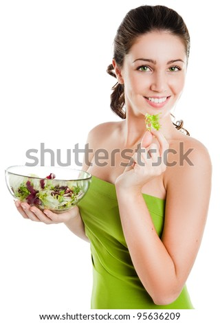 Healthy lifestyle - young woman eating salad  smiling happy looking at camera.