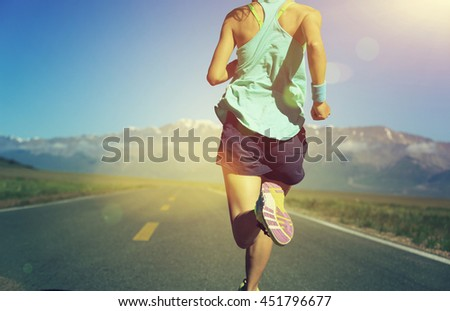 healthy lifestyle young woman runner running on trail #451796677