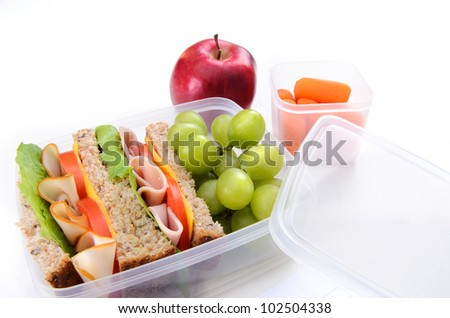 Healthy living packed lunch with sandwich, apple and carrots