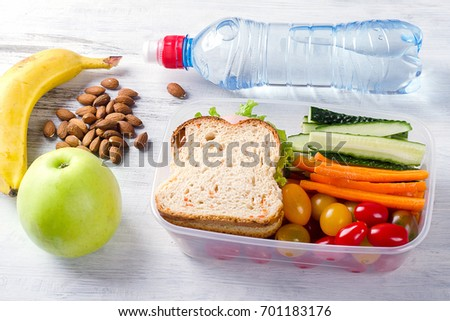 Shutterstock Healthy lunch box with sandwich and fresh vegetables, bottle of water. Healthy eating concept. Top view