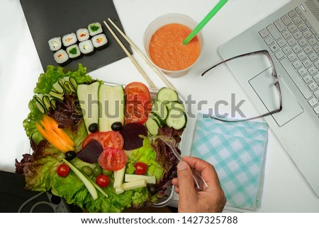 Healthy lunch. Lettuce salad, yellow pepper, tomatoes, beet, olives, courgette and cucumber. Accompanied with sushi appetizers and a smoothie of carrots, yogurt, pineapple and apricots. #1427325788