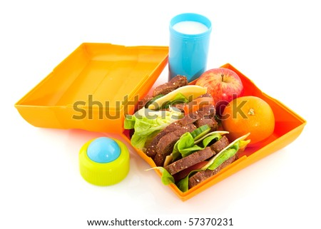 Healthy lunchbox with wholemeal bread milk and fruit