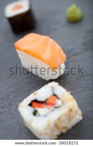 Healthy Maki & Nigiri sushi on a slate with wasabi. Shallow DOF