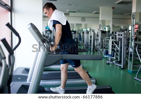Healthy man a treadmill in a sport center