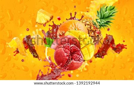 Healthy mango, pomegranate, pineapple, orange fruit juices mix liquid splashes. Fresh fruits juice splashing together- orange, pineapple, pomegranate, mango juice drink splashing. Clipping path. 3D