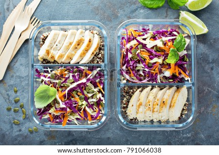 Healthy meal prep containers with quinoa, chicken and cole slaw overhead shot - Shutterstock ID 791066038