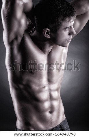 Healthy muscular young man. Black and white photo