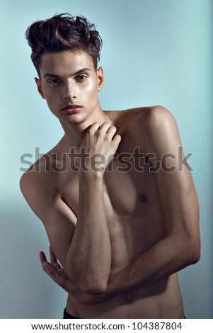 Healthy muscular young man in studio - stock photo