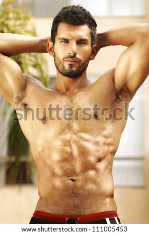 Healthy muscular young man with nice abs