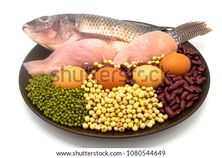 healthy natural food and diet concept - high protein many beans and meat, red beans, green beans, soy beans, egg, chicken and fish in the brown dish isolated on white background