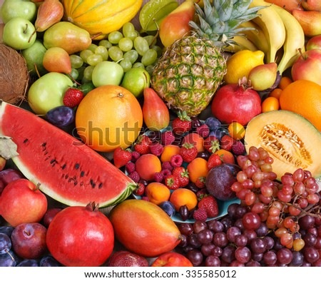 Healthy natural fruit background / food photography of the variety of fruits at the market. Copy spacy for your text. High resolution product #335585012