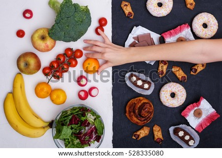 Healthy nutrition concept. Fruits and vegetables vs sweets and unhealthy food.