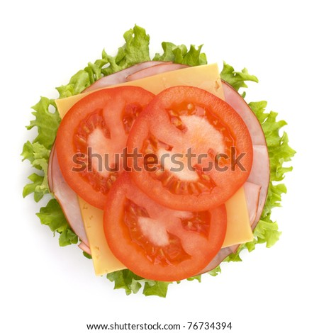 Healthy open sandwich with lettuce, tomato, smoked ham and cheese isolated on white background