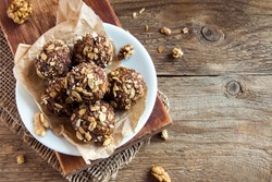 Healthy organic energy granola bites with nuts, cacao, banana and honey - vegan vegetarian raw snack or meal