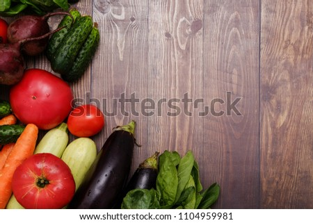 Healthy organic foods on wooden background. Top view #1104959981