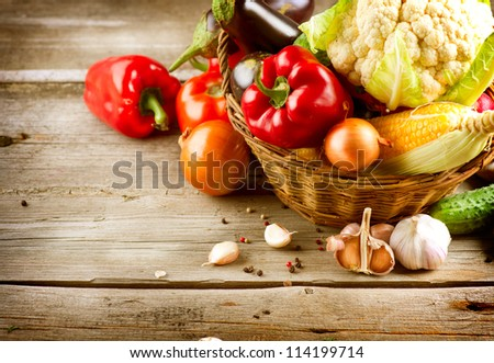 Healthy Organic Vegetables on a Wooden Background. Art Border Design #114199714