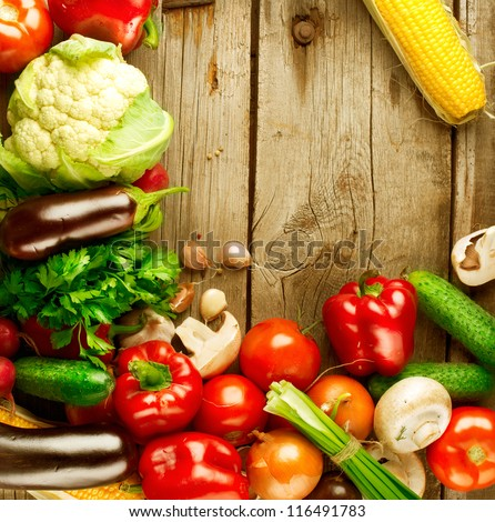Healthy Organic Vegetables on a Wooden Background. Frame Design