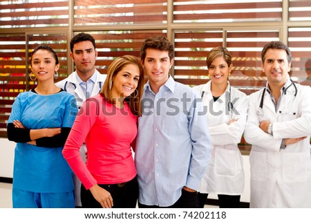 Healthy patients at the hospital with doctors on the background