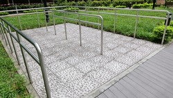 Healthy pebble walking trial locate in the park at Hong Kong for elderly persons to walk through and massaging food board acupuncture points