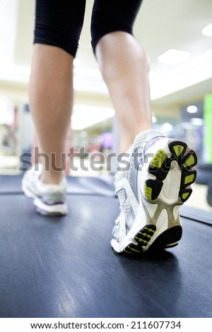 Healthy people  doing fitness exercise  in a sport center