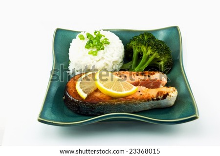 Healthy portion of fresh wild coho salmon with half cup of rice and steamed broccoli
