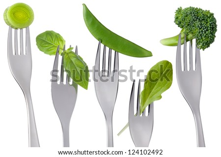 healthy raw green food on forks isolated against white - stock photo