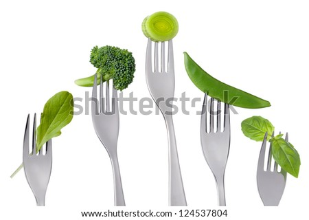 healthy raw green vegetable on forks isolated