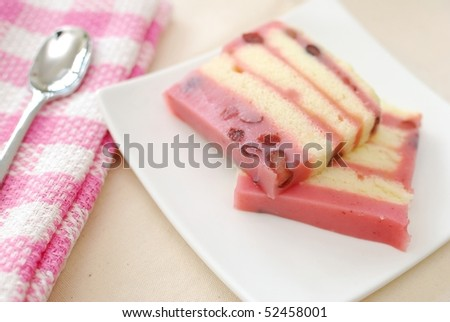 Healthy red bean cake for dessert with spoon. For concepts such as food and beverage, diet and nutrition, and celebrations and festive.