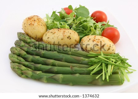 Healthy restaurant diet food promoting weightloss, potatoes, salad, asparagus and onion on white, macro, close up, copy space, isolated