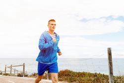 Healthy running man on beach