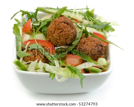 healthy salad in a bowl with ball patty