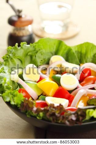 Healthy salad with quail eggs - stock photo