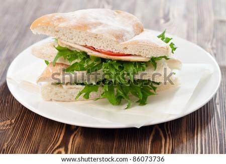 Healthy sandwich on wooden background