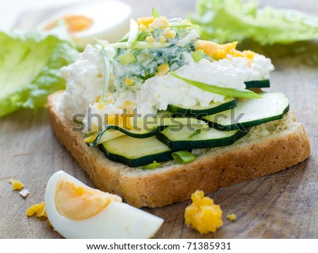 Healthy sandwich with cottage cheese and cucumber for breakfast