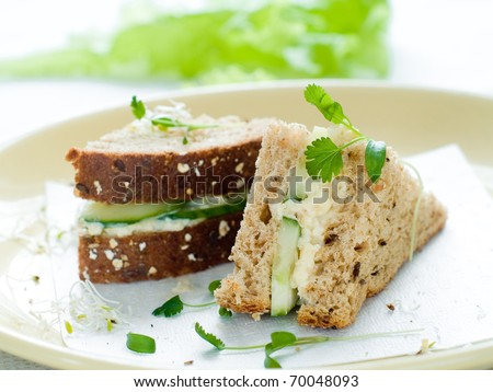 Healthy sandwich with fresh cucumber and egg for breakfast - stock photo